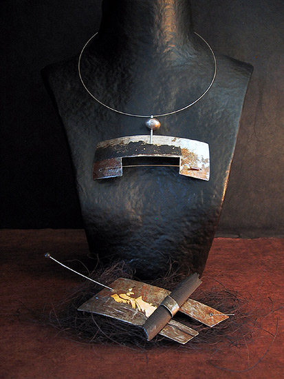 Necklace and brooch: recycled metal oxidized patinated with gold leaf Jewellery