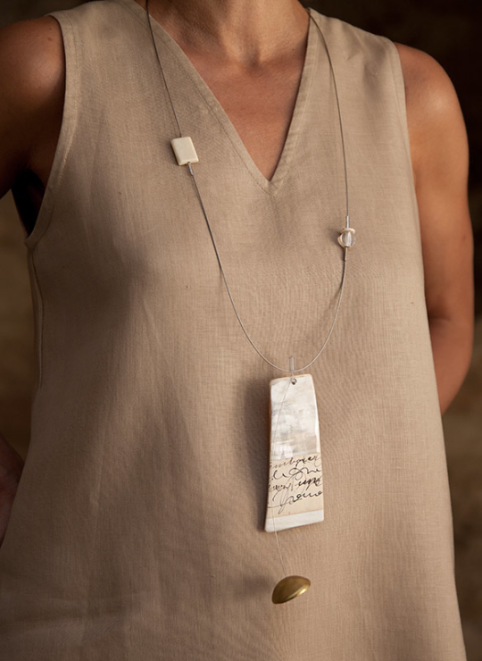 Contemporary jewel: horn necklace on stainless steel cable Jewellery