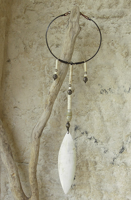 Necklace: long pendant made of horn, ethnics beads( old agate, indian and african beads, ostrich eggshells and bone), hammered iron and leather Jewellery