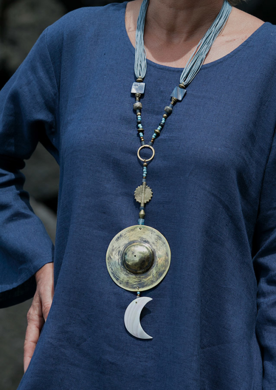 Blue and golden hues for this mother of pearl talisman. Softly polished hand hammered brass disc. Jewellery