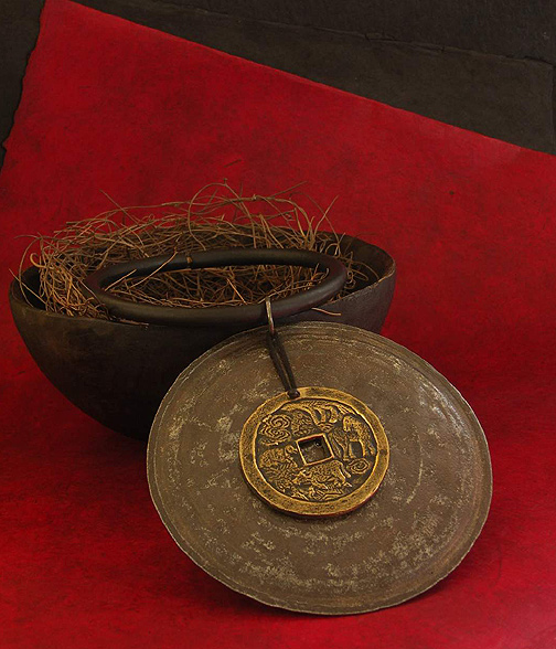 Large hammered iron disc adorned with an ancient chinese coin Jewellery