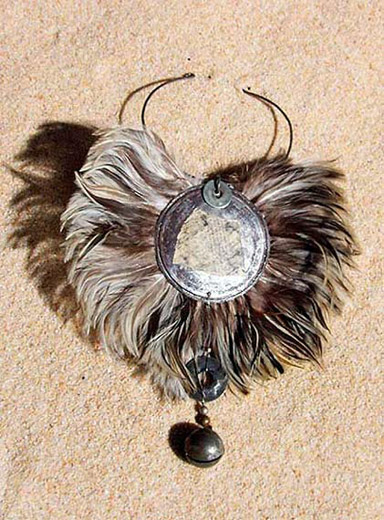 Bib feather necklace with an african bronze  bell Jewellery