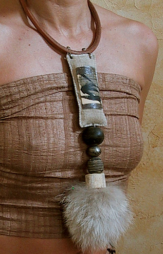 Tribal necklace:African beads, wolf hair, bone and leather Jewellery