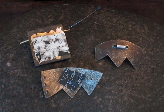 Contemporary brooches: oxidized and recycled metal Jewellery