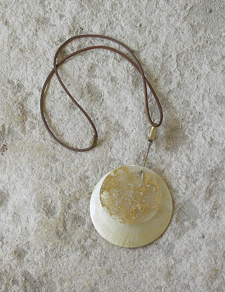 Necklace: big mother of pearl disc, gold foil, leather string Jewellery