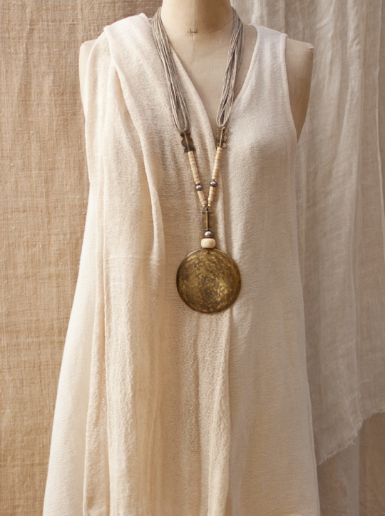Hammered bronze pendant with bone and ethnic beads Jewellery