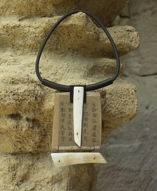 Large necklace made of horn, paper and rubber Jewellery