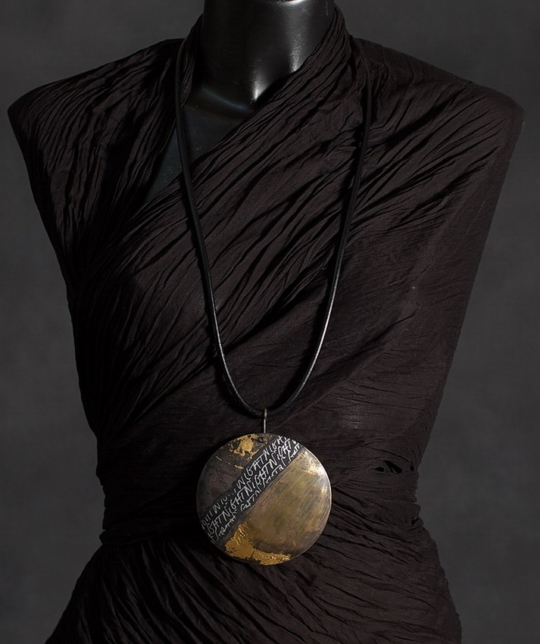 Pendant necklace: oxidized brass with gold leaf [category]