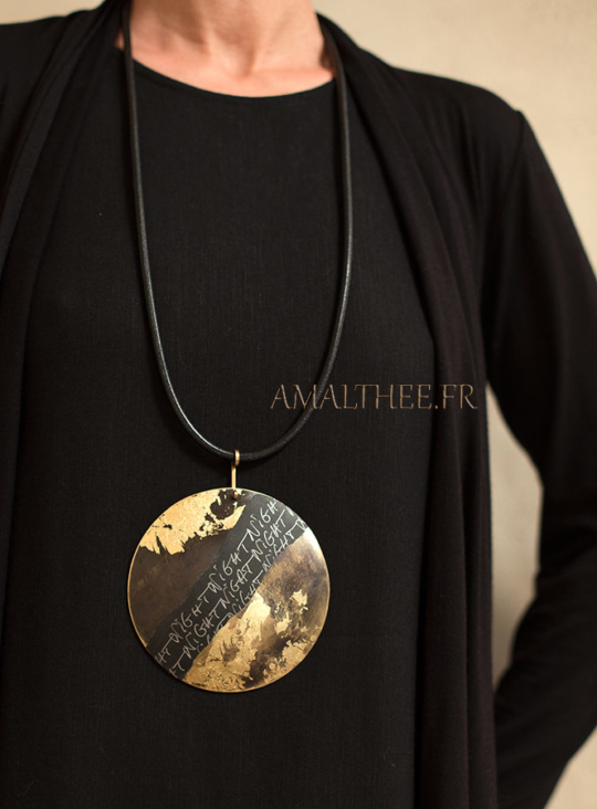 Stunning contemporary oxidized brass disc with gold leaf  and original calligraphy Jewellery