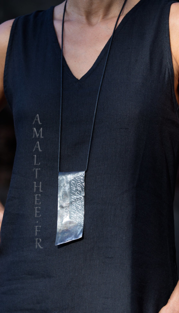 Contemporary jewellery: reclaimed hammered iron pendant with original calligraphy Jewellery