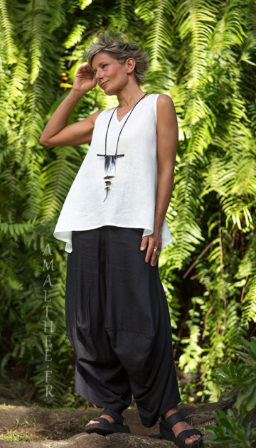 Loose fit black linen pants with drape legs Looks